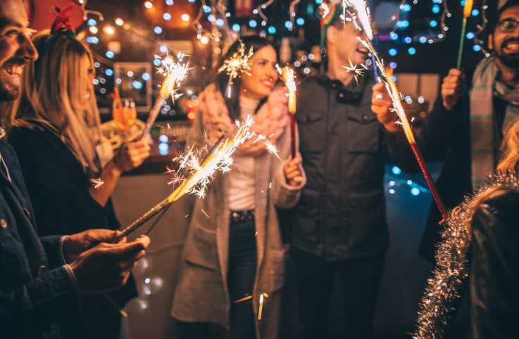 New Year's fun with a group of friends and sparklers.