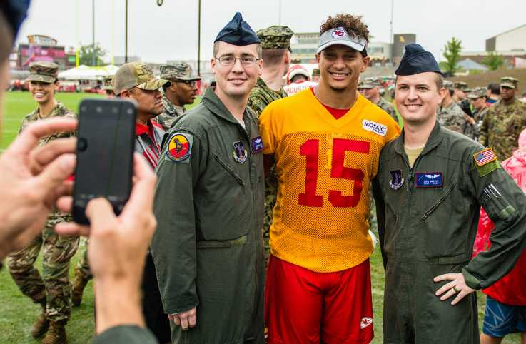 Members of the 139th Airlift Wing, Missouri Air National Guard, pose for a photo with Patrick Mahomes, quarterback for the Kansas City Chiefs football team, at the Chief's training camp in St. Joseph, Mo., Aug. 14, 2018.