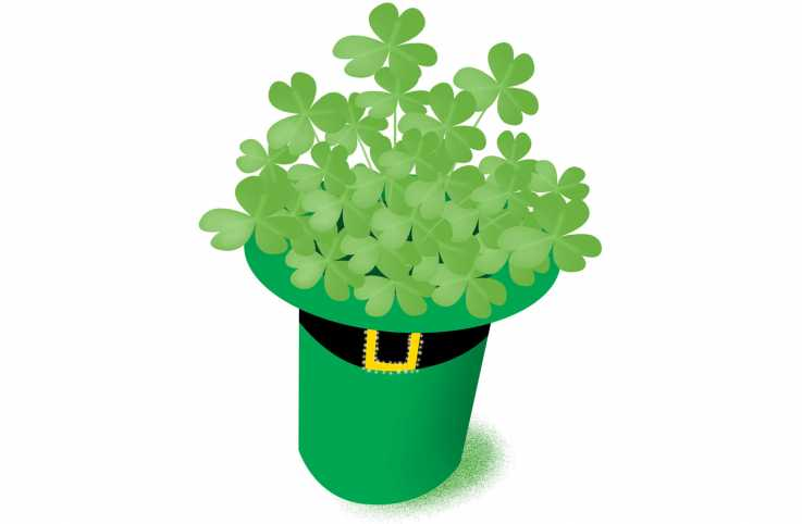 A leprechaun's hat filled with green clovers.