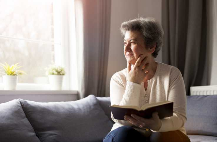 A senior woman with her Bible opened.