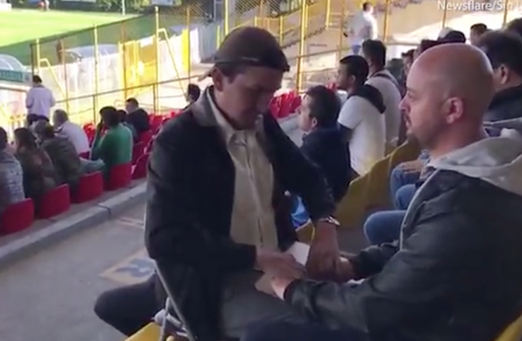 Cesar Daza has invented a way for his friend Jose Gallego, who's blind and deaf, to enjoy the World Cup.