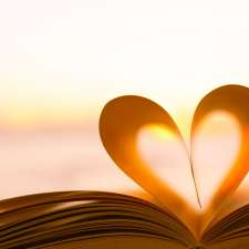 A book with its pages curved into a heart.