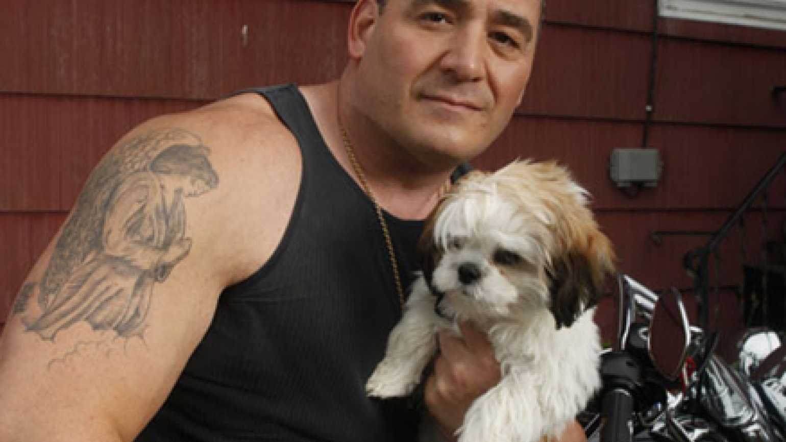 A member of Rescue Ink with one of the dogs the group rescued