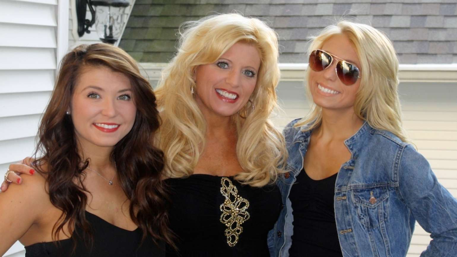 Michelle Medlock Adams with her daughters Abby (left) and Ally (right).