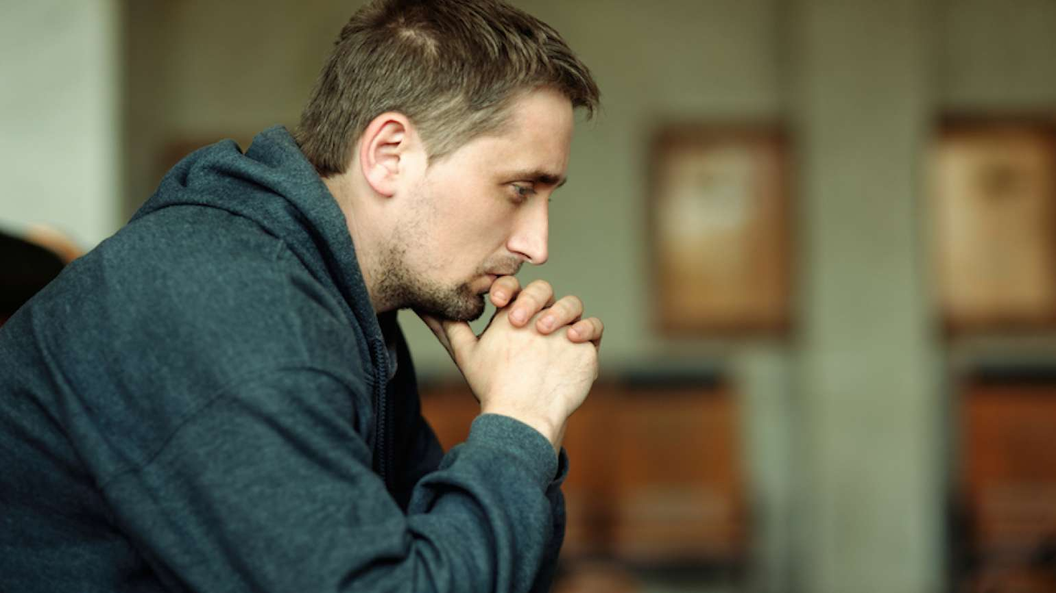 Man praying. Shutterstock.