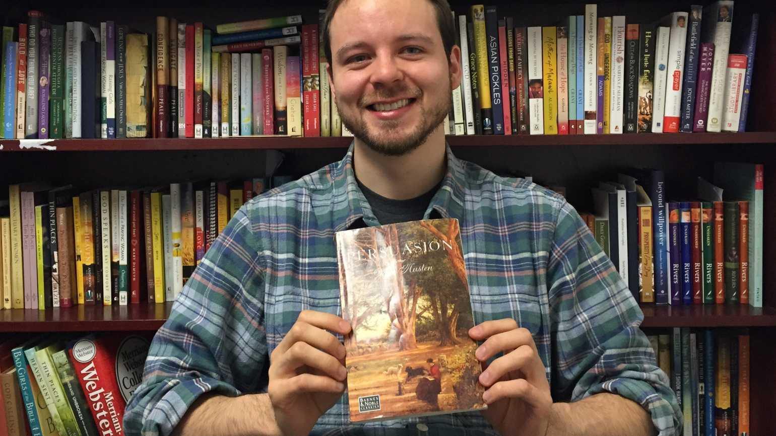 Daniel Kessel holding his copy of Jane Austen's Persuasion.