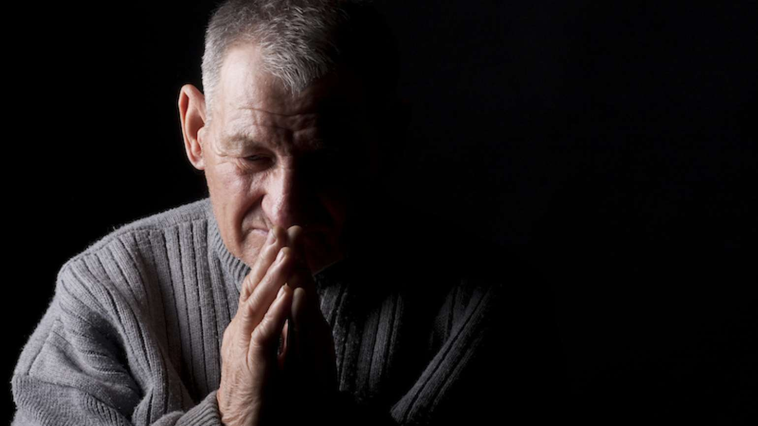 Praying for others. Photo by Andrei-md, Thinkstock.