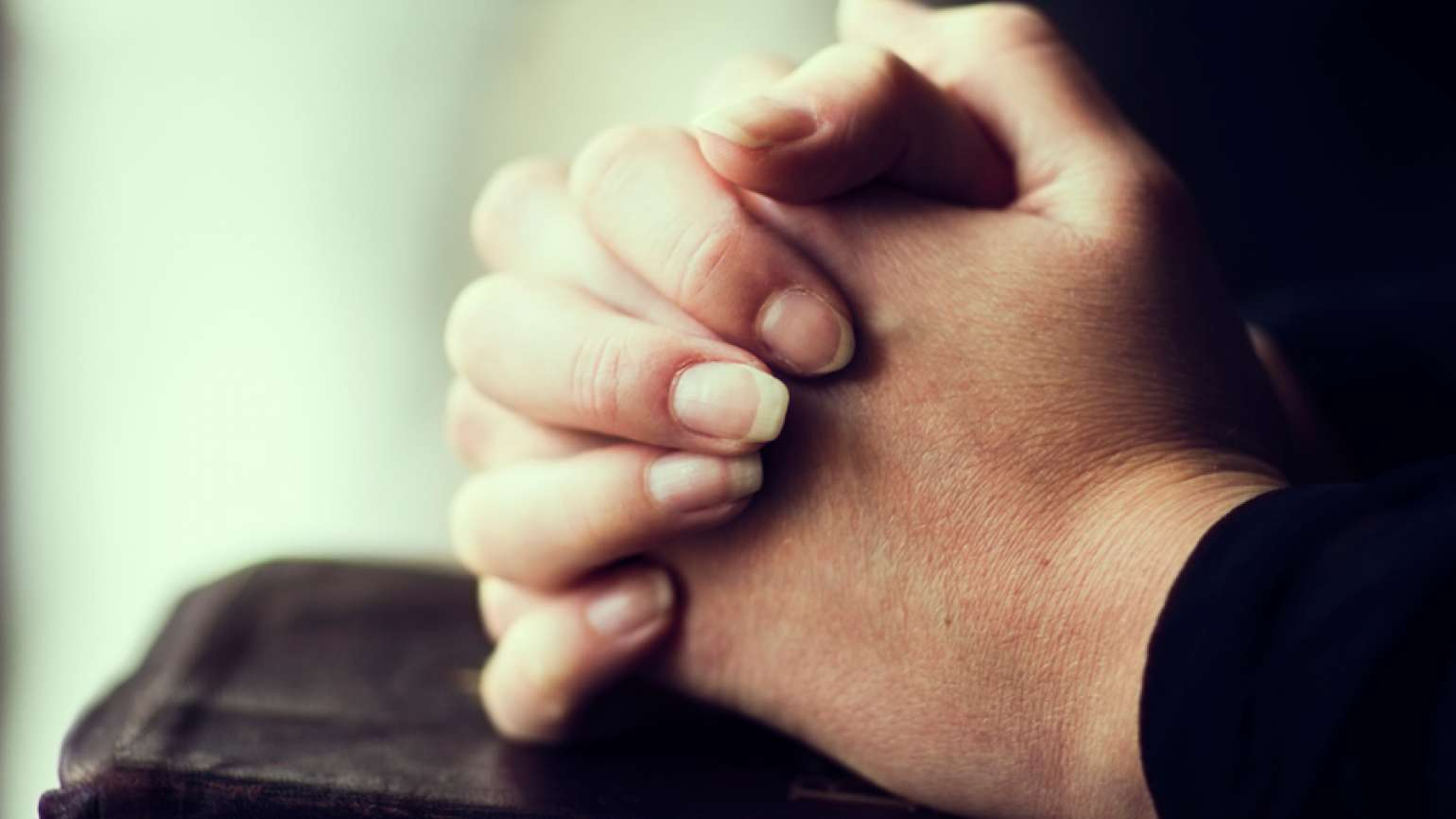 Guideposts: Hands clasped in prayer