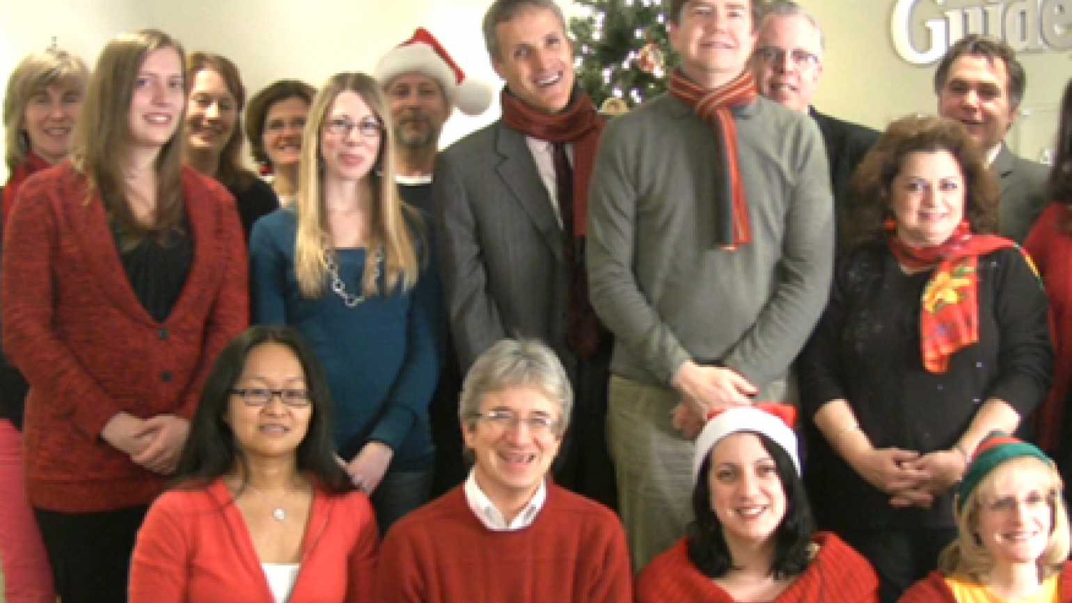Guideposts staffers singing Hark! The Herald Angels Sing