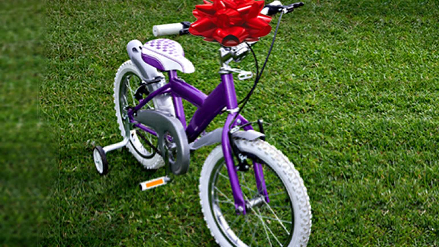 A girl's bike with a large red bow