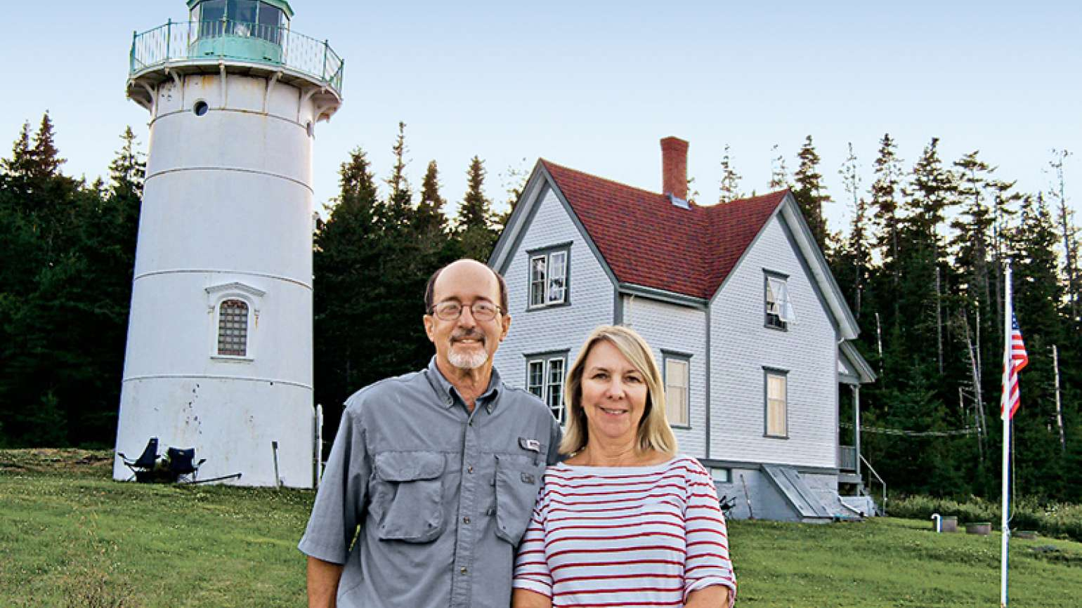 Chuck Turk and his wife, Marilyn, pose in front of the Little River Lighthouse.