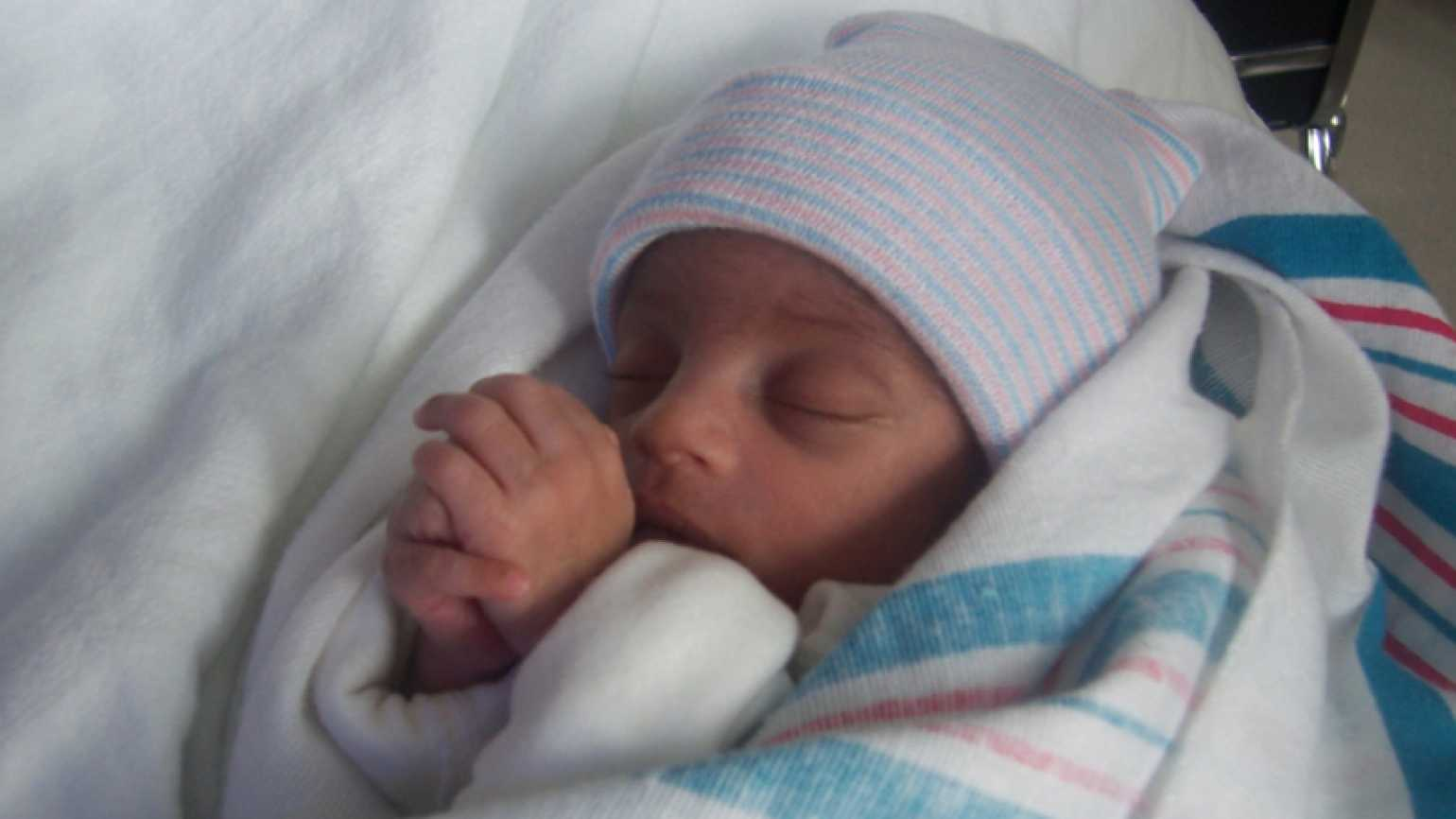 Crystal Clark-Archer's son, Izaiah, with his hands together as in prayer.