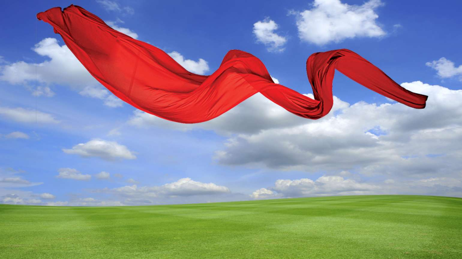 A long red scarf floats on the breeze.