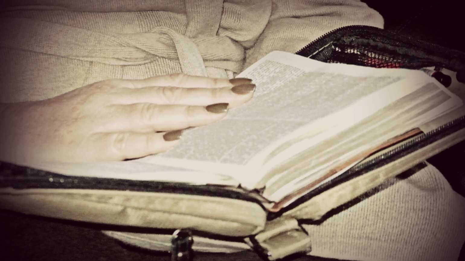 Outreach Ministries blogger Edie Melson reading her Bible
