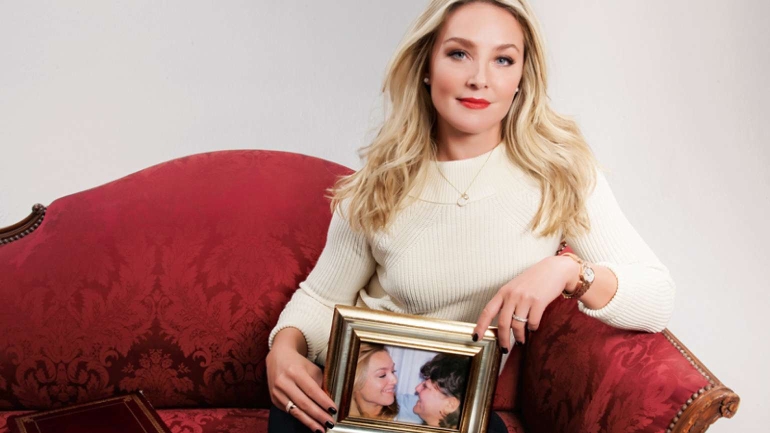 Elisabeth Rohm poses with a framed picture of her with her mother.