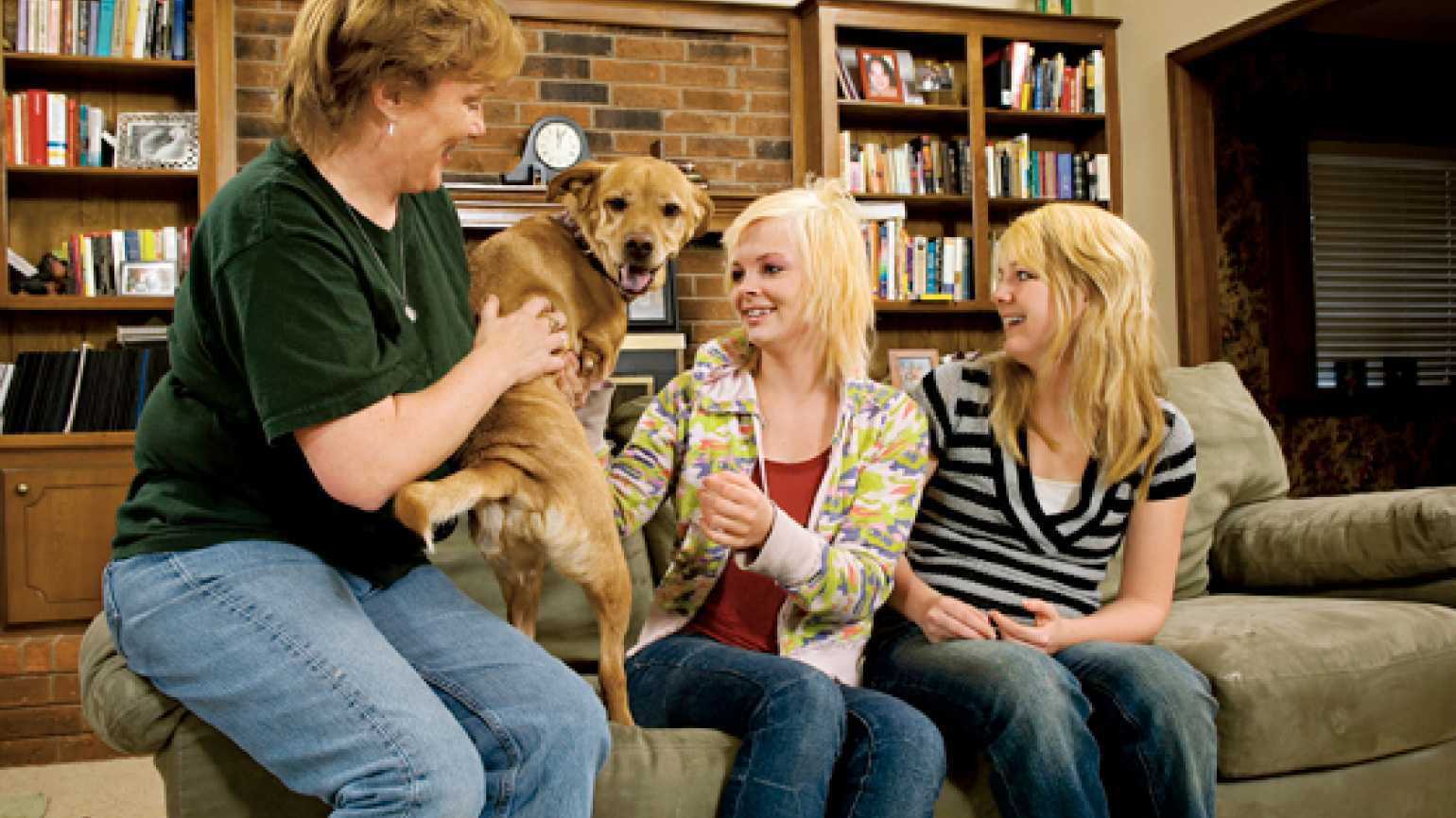 Faith the dog with her family
