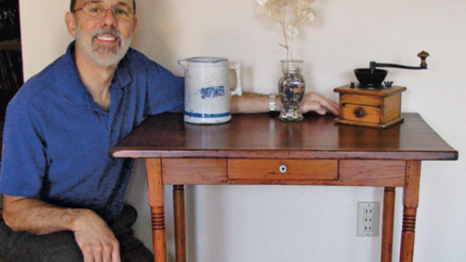 Garry Zalesky poses with his restored table.