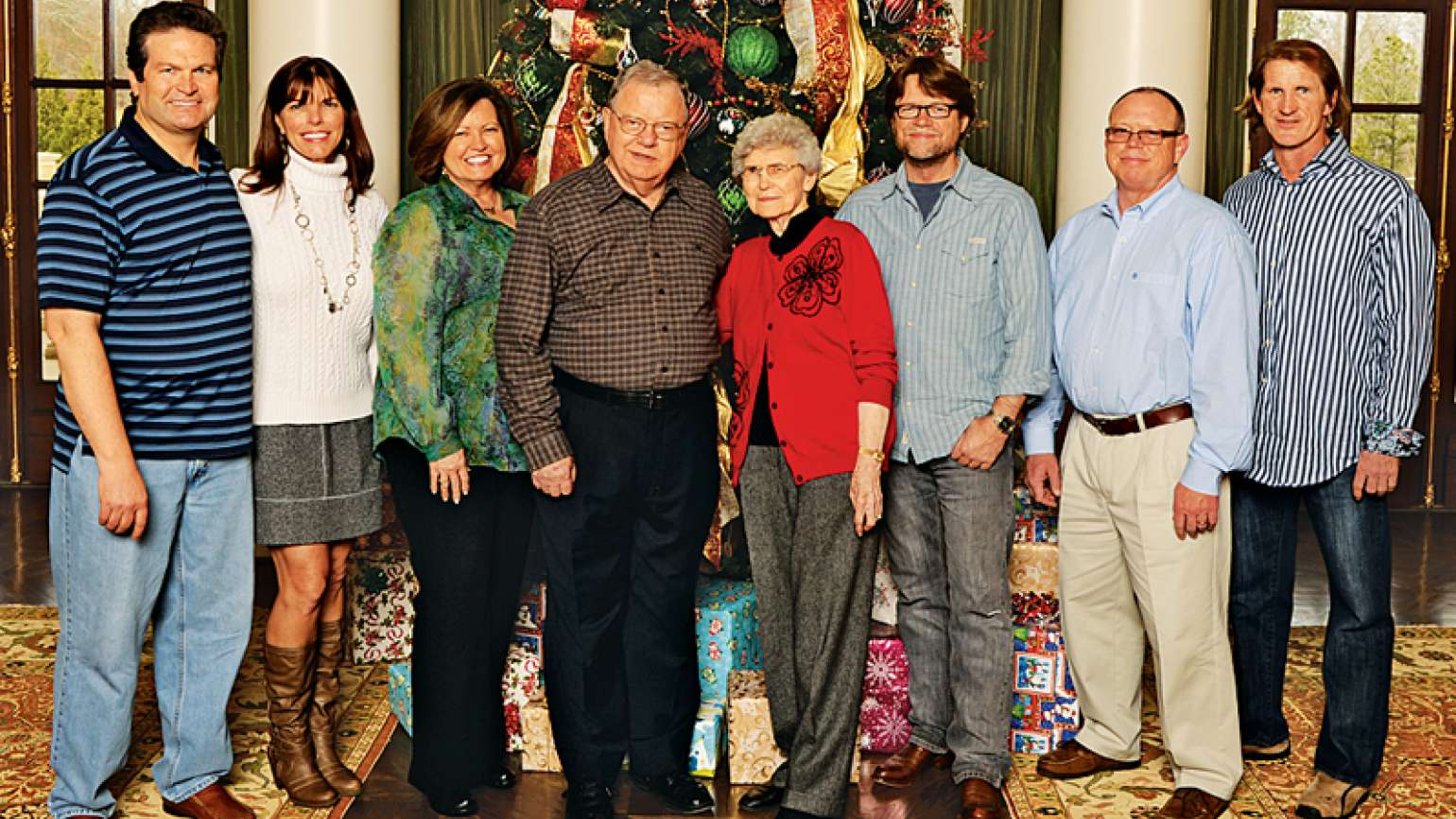 Rick and his family in 2012; his foster parents, the Prices, are in the center