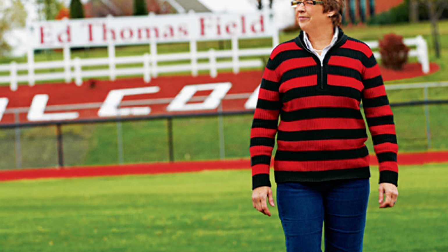 Jan Thomas at the football field named after her late husband