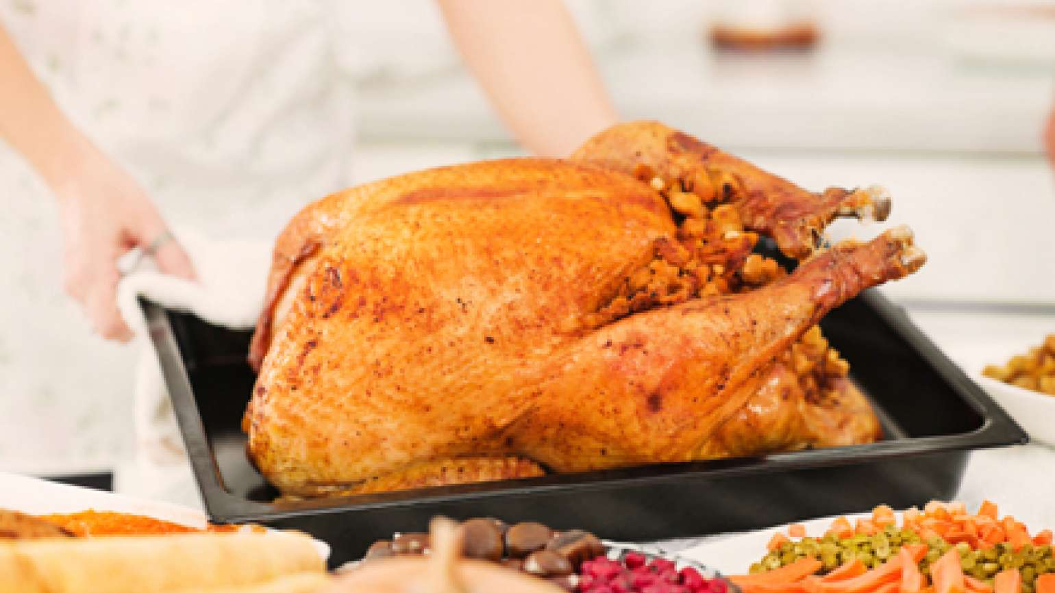 A Thanksgiving turkey with side dishes