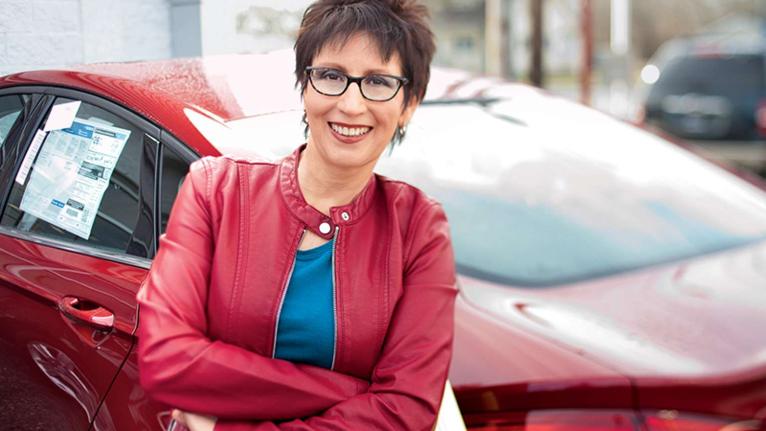 Susan Karas poses by the new car she purchased.
