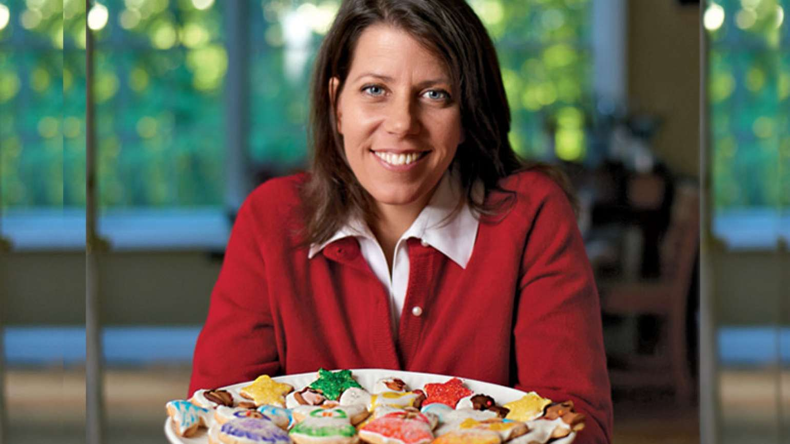 Michelle Mahnke poses with a platter of her Christmas Cut-Out Cookies.