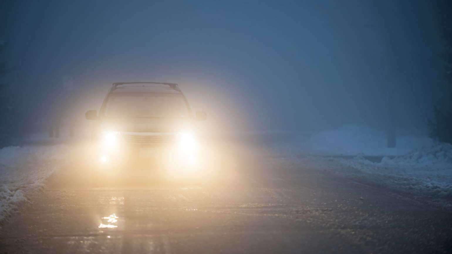 Headlights on a dangerous road. Photo by Elenathewise, Thinkstock.