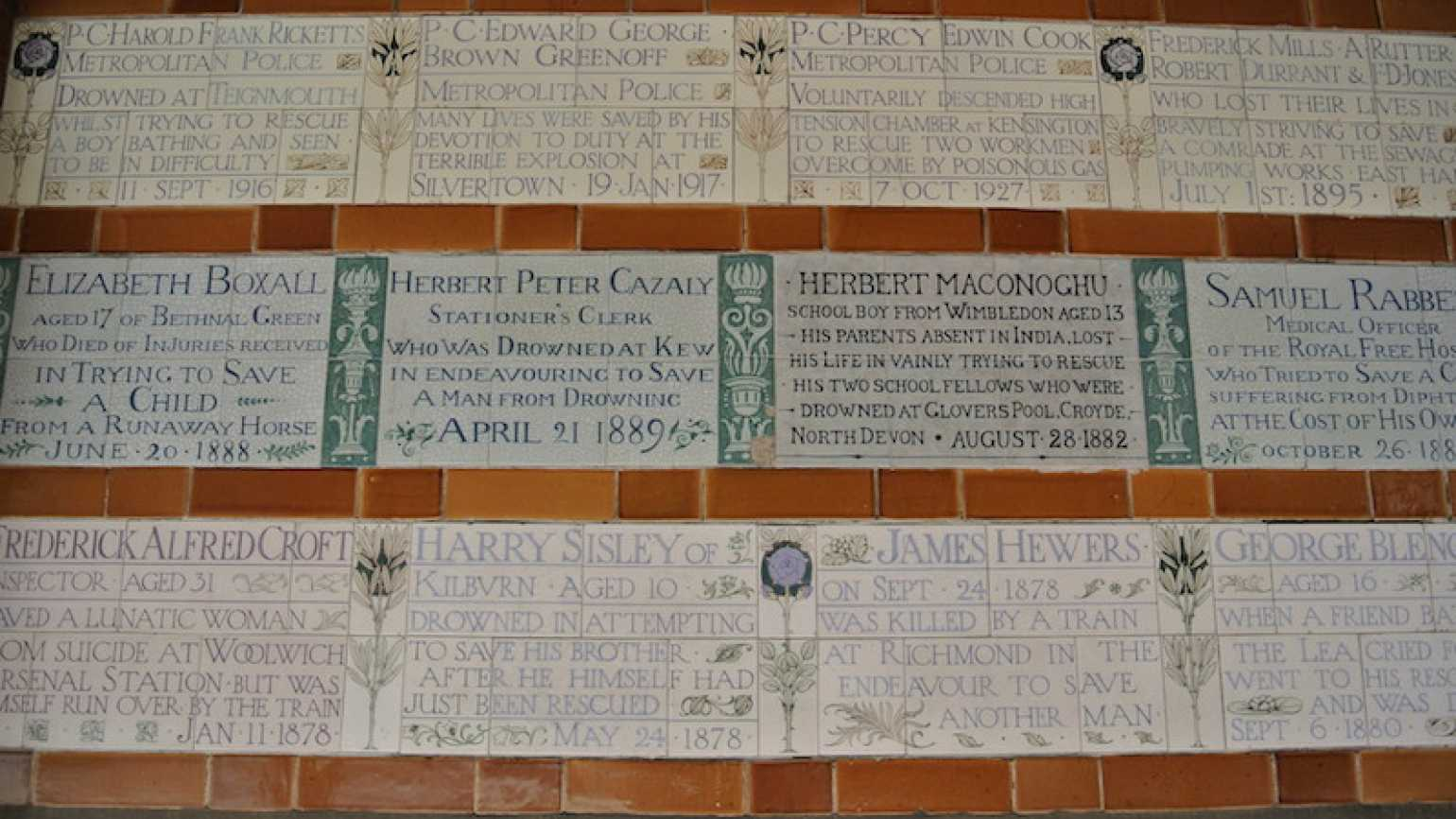 Wall of memorial plaques at Postman's Park in London.