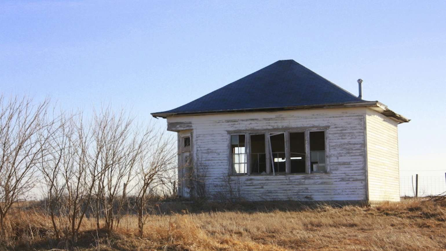 A home that needs fixing. Photo by Darcy Maulsby, Thinkstock.