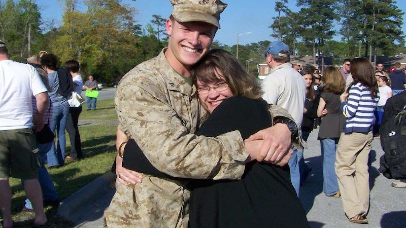 Guideposts: Edie hugs her son Jimmy after his first deployment.