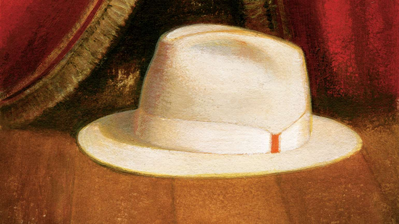 An artist's rendering of a tan fedora on a stage before a red velvet curtain