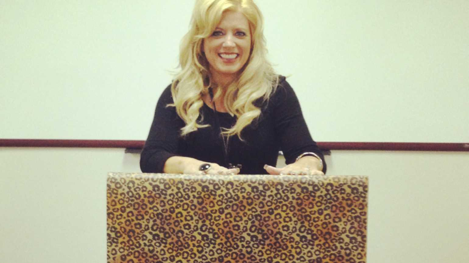 Inspirational Stories blogger Michelle Medlock Adams at a leopard print podium