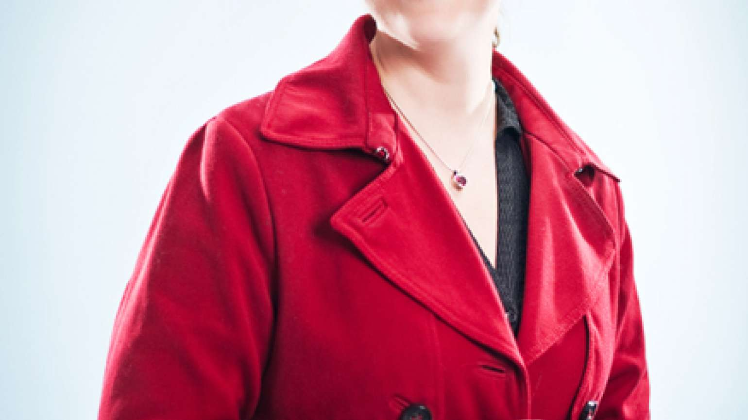 A woman wearing a red woolen coat