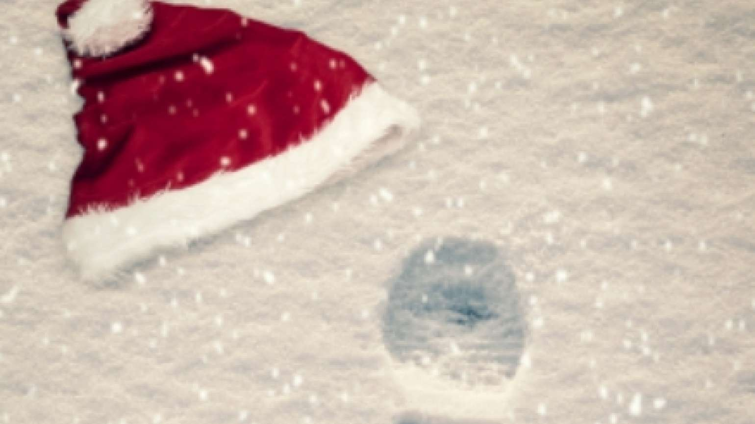 Santa hat and bootprints in the snow