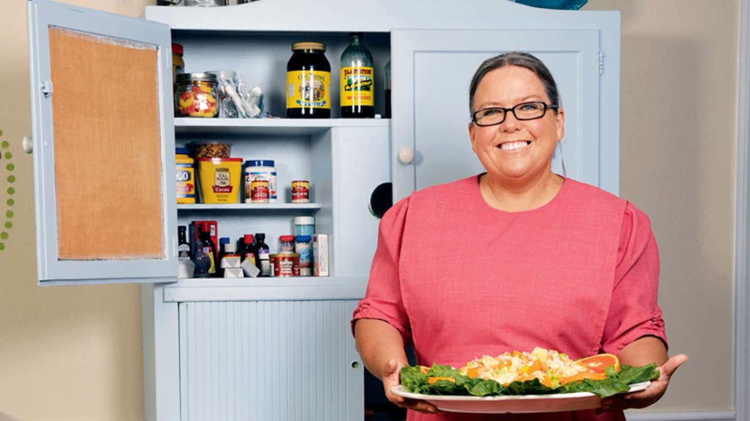 Sherry Gore with a platter of her tropical chicken salad