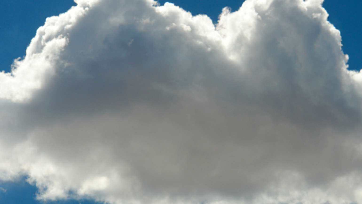 A single gray cloud in an otherwise blue sky