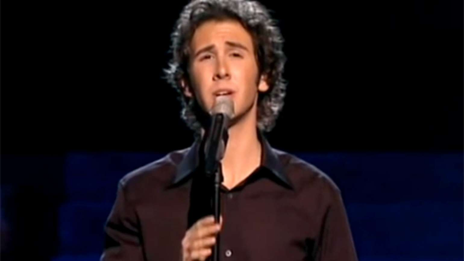 Josh Groban performs for a live audience.