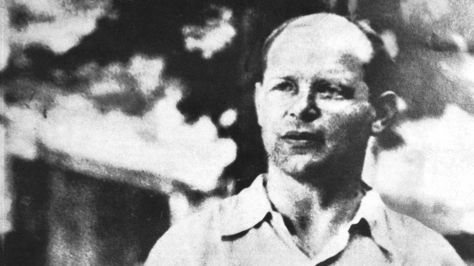 A black and white portrait of Dietrich Bonhoeffer.