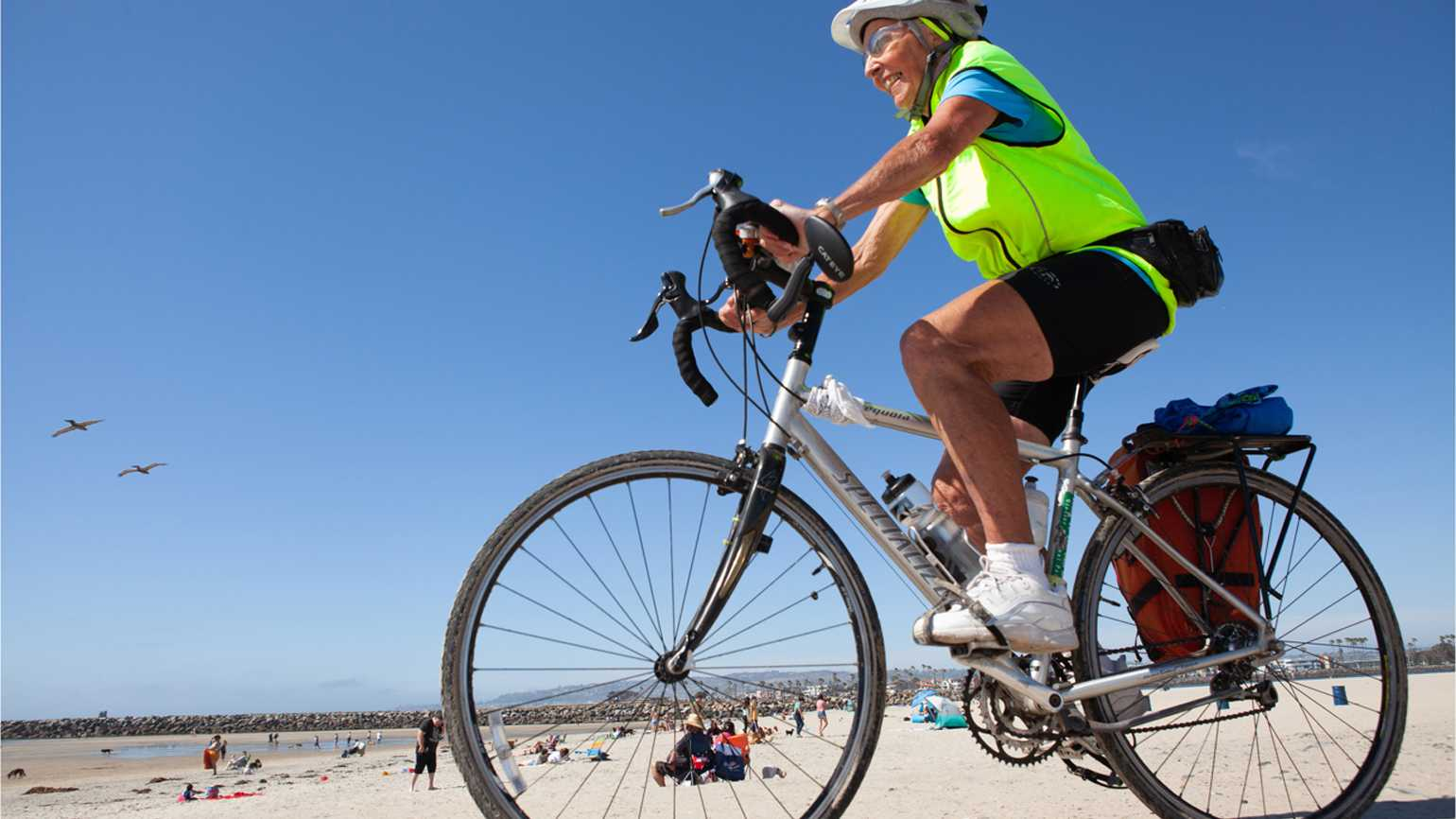 Carol Garsee riding her bike on Dog Beach in San Diego, California.