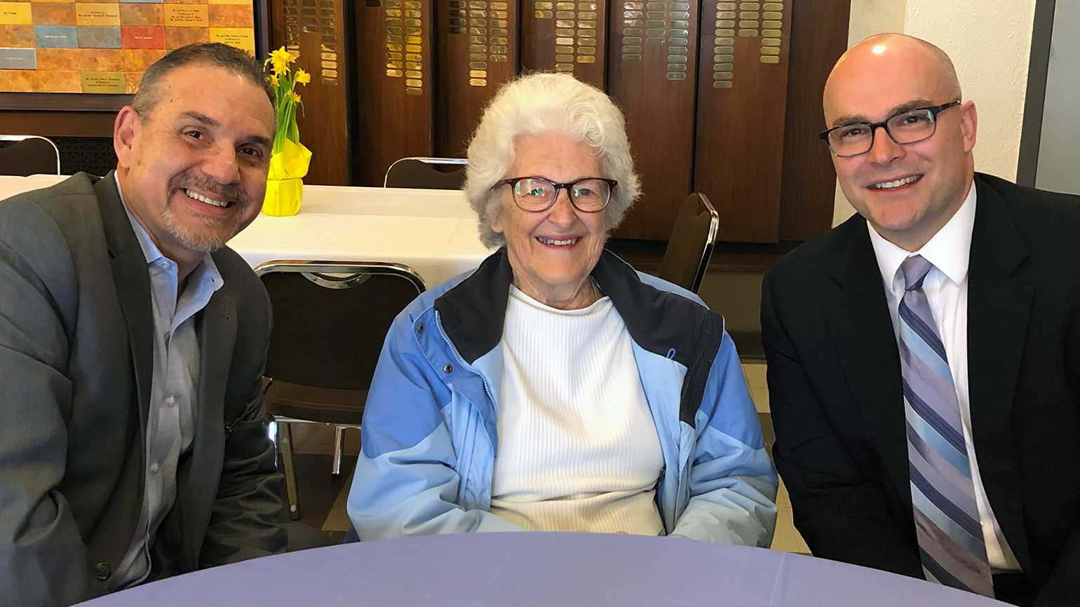 Pablo R. Diaz (left), Vice President of Ministries and Guideposts President & CEO John Temple spend time with an attendee at Good Friday Day of Prayer