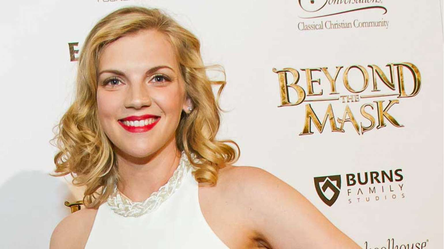 Actor Kara Killmer takes to the red carpet during the Detroit premiere of BEYOND THE MASK-- the revolutionary family adventure film in theaters on June 5, 2015.
