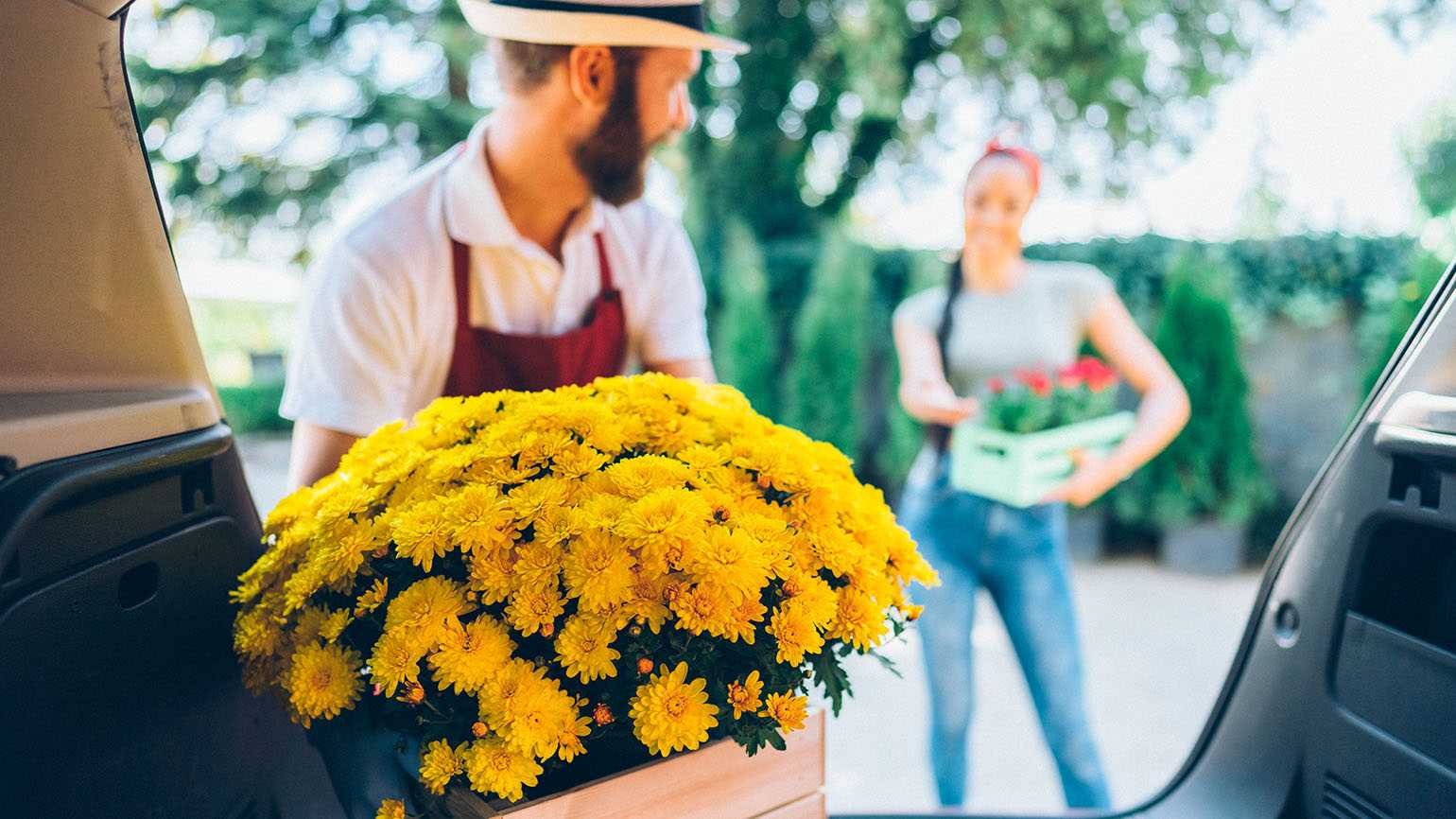 Man delivering flowers to a young woman