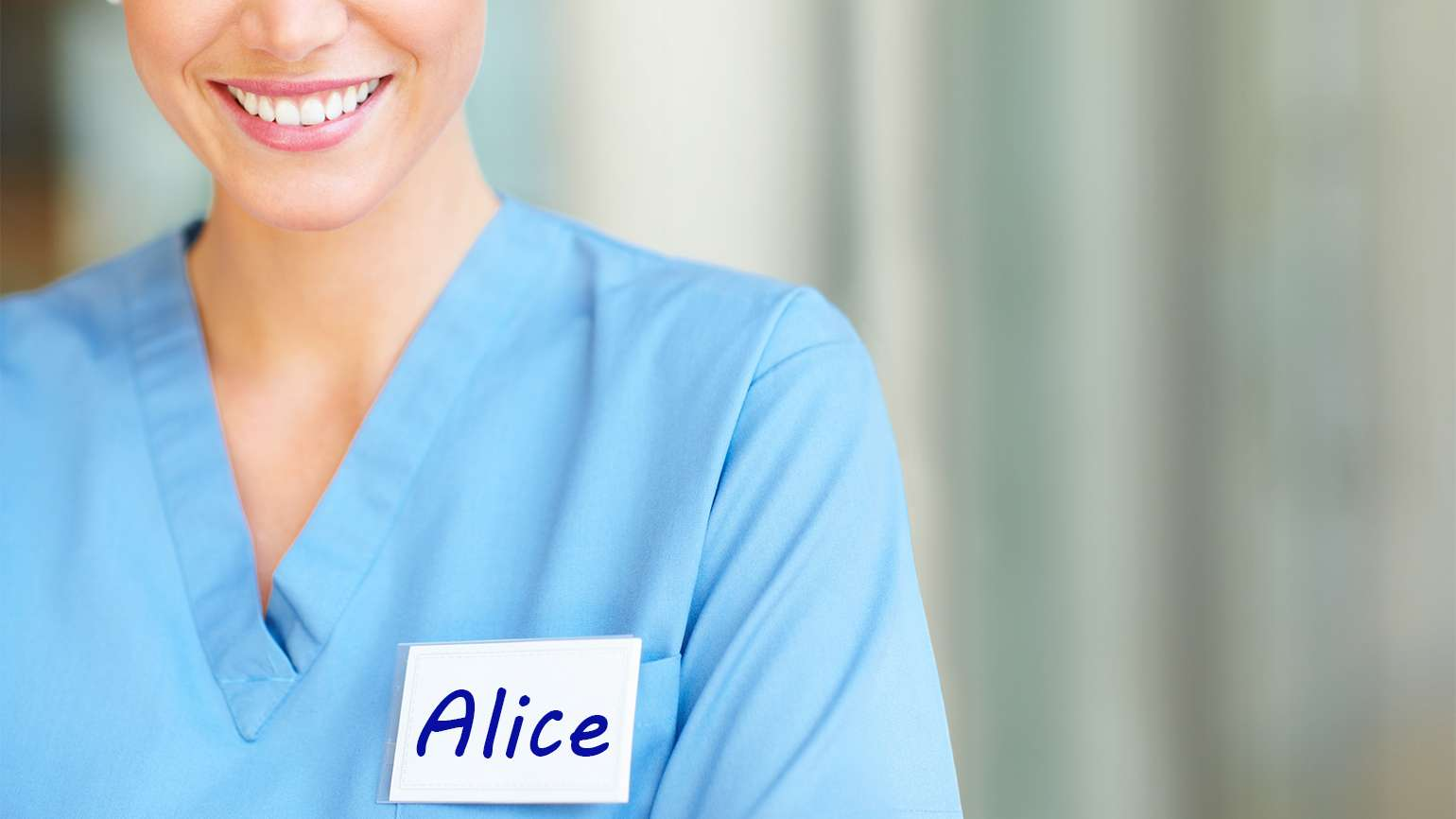 "A smiling nurse with a name tag that reads ""Alice"""