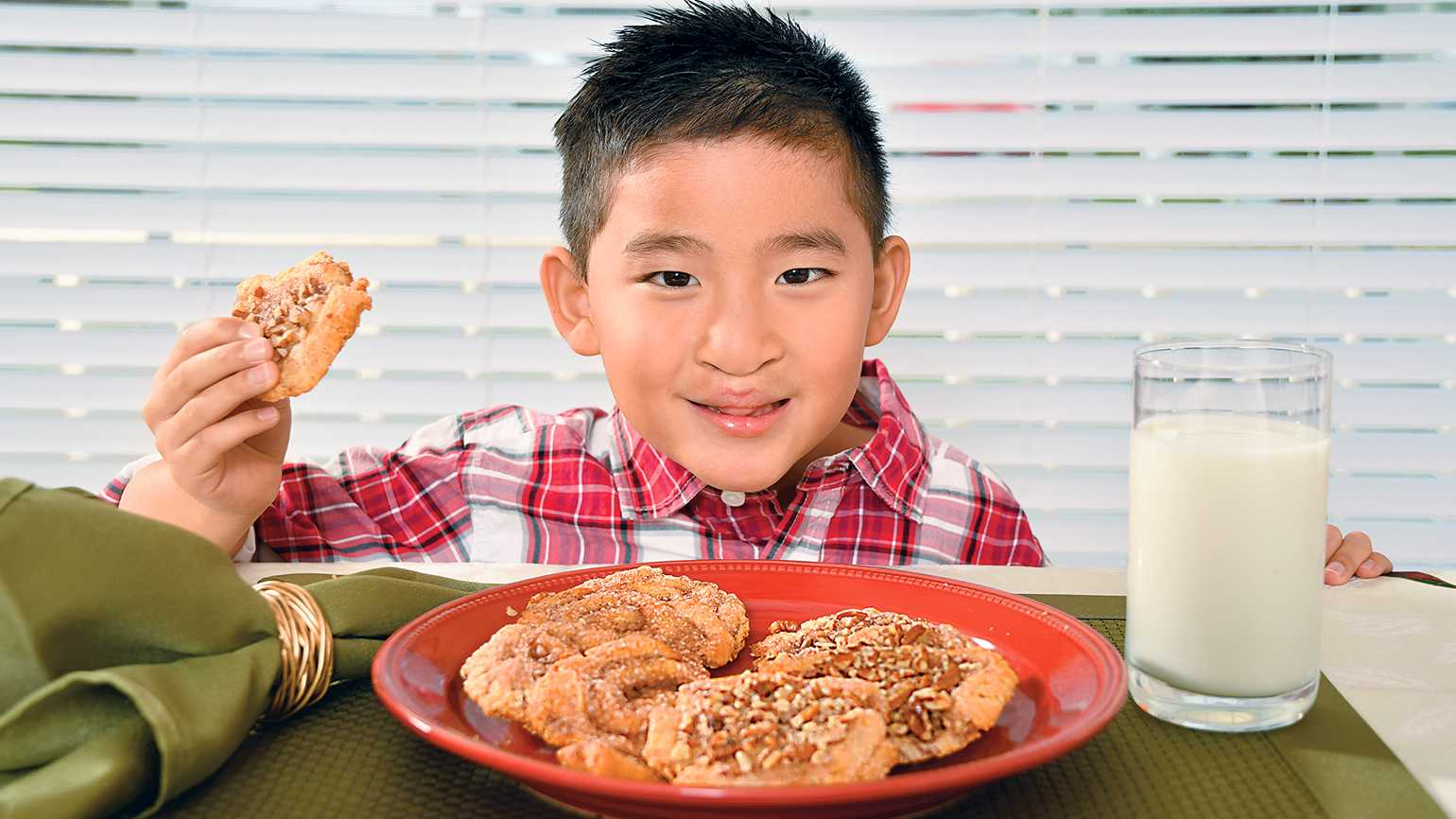 Becky's son Samuel smiles over a plate of the cinnamon crips that he helped to make