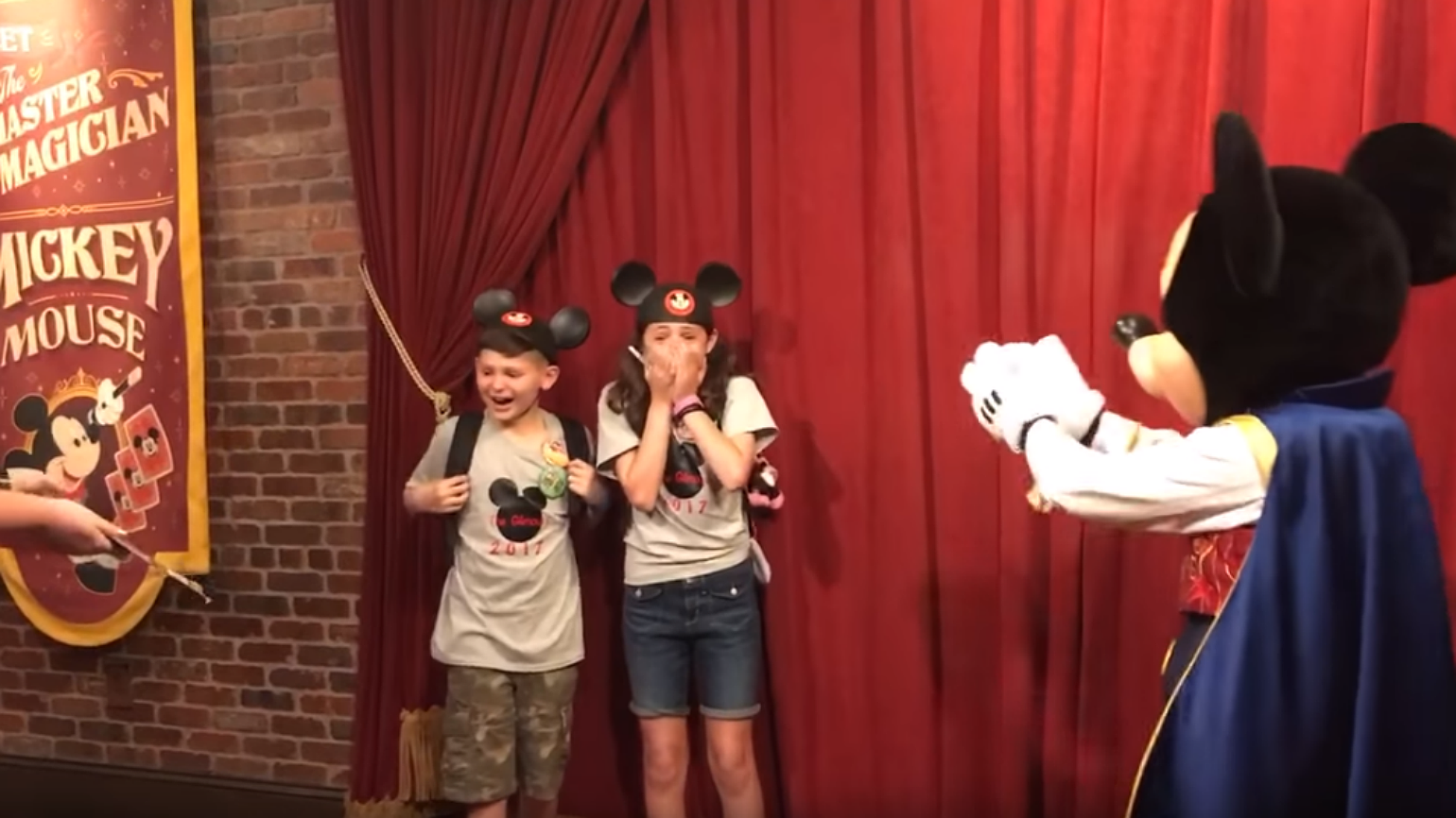 Watch Mickey Mouse Tell These Two Kids They've Been Adopted