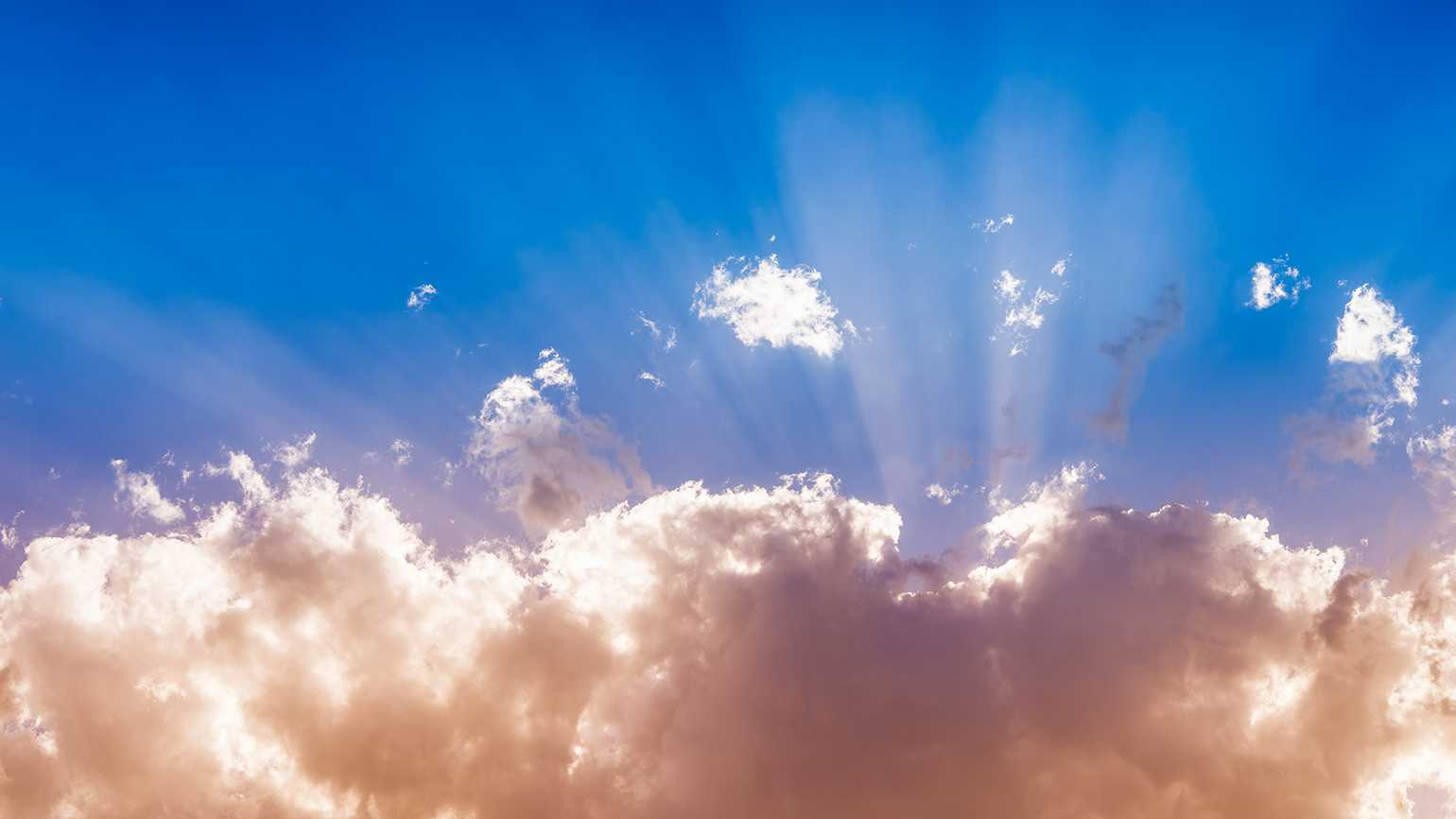 Heavenly beams stream through clouds