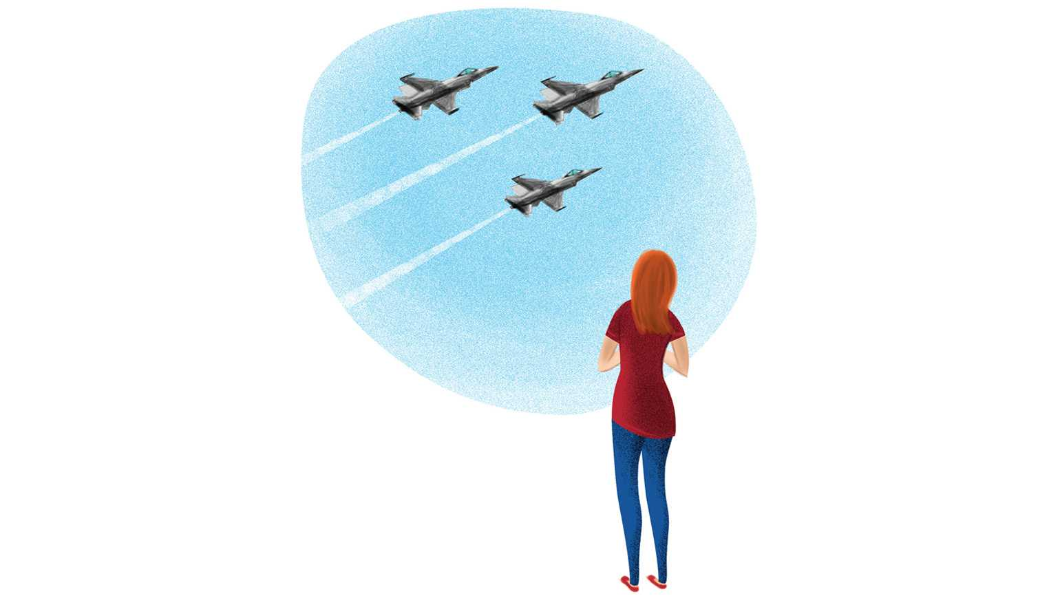 A woman looking to the blue sky as three jets zoom by.