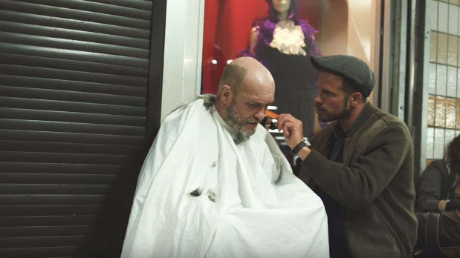 Joshua Coombes giving haircut to  homeless person