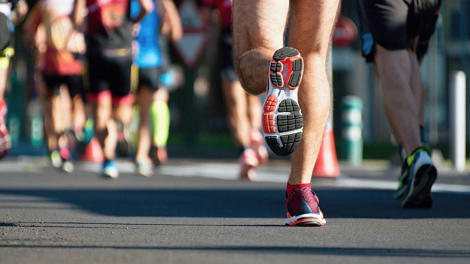The feet of a group of long-distance runners
