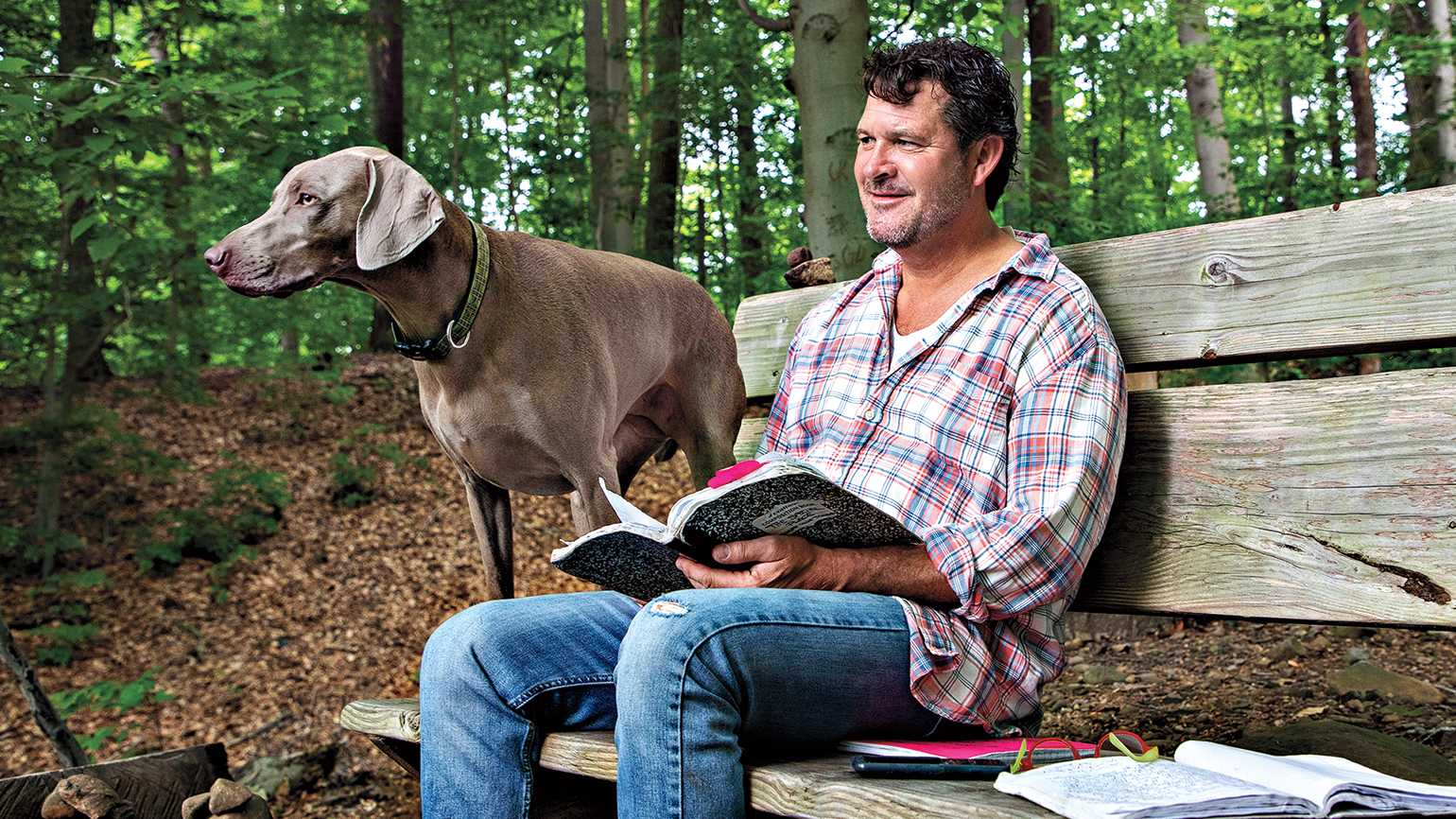 Mark and new Weimaraner Hazel on the bench he made